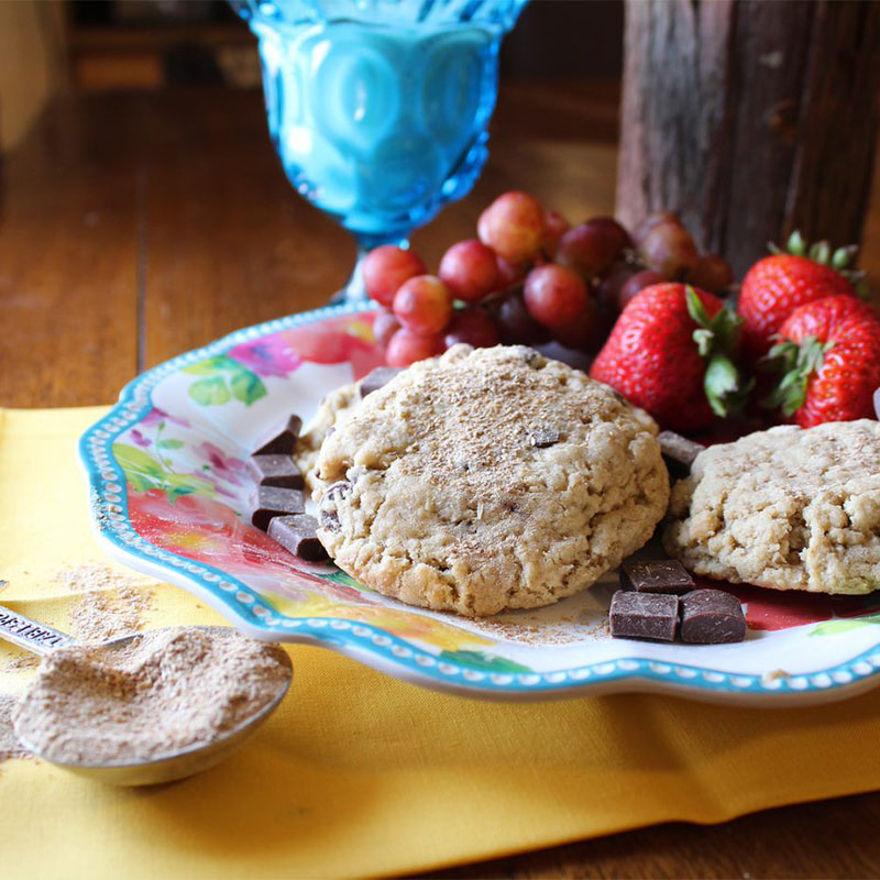 Defatted Wheat Germ sprinkled on cookies with fruit in the background